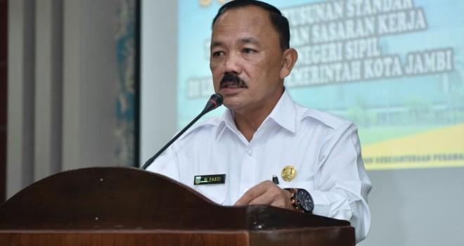 Pjs Wali Kota Jambi M Fauzi, menyampaikan Sambutan pada acara kegiatan bimbingan teknis penyusunan standar teknis sasaran kerja pegawai di lingkungan Pemkot Jambi.