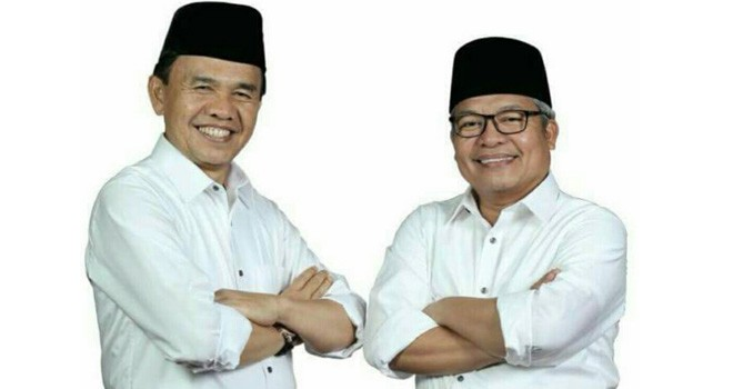Adi Rozal dan Ami Taher, Bupati dan Wakil Bupati Kerinci terpilih hasil Pemilu kepala daerah 2018 lalu. Foto : Ist