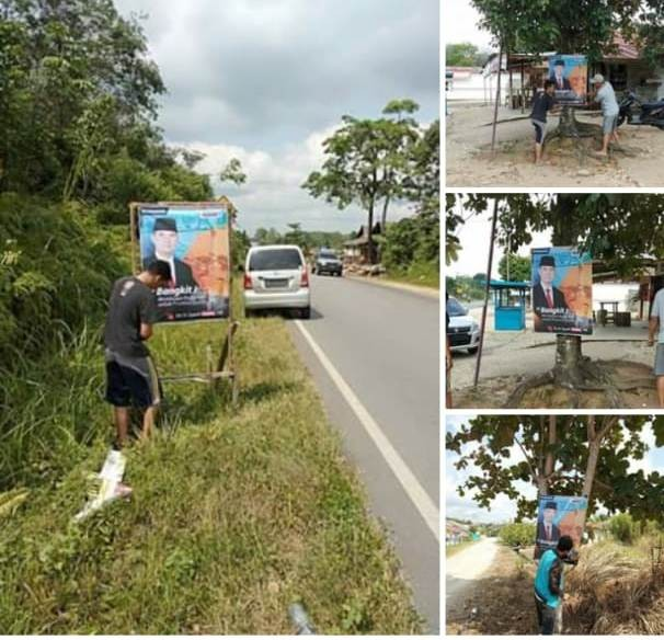 Relawan memasang baleho Sy Fasha di Singkut