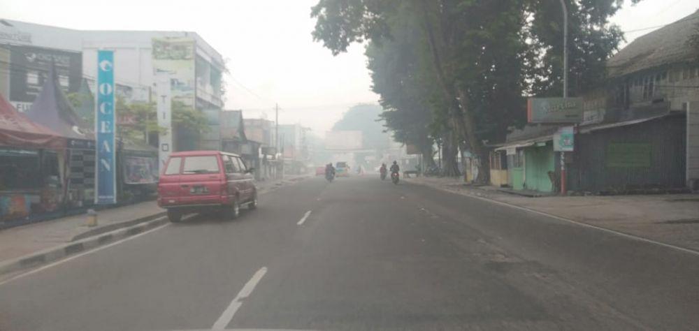 Kondisi kabut di Kota Jambi pagi ini (16/10).