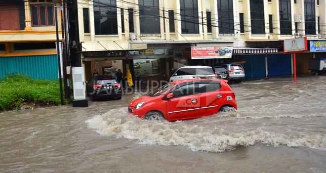 Banjir yang terjadi dikota Jambi berapa pekan lalu.