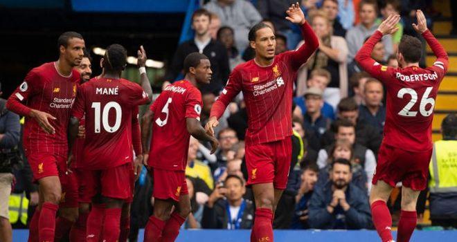 Liverpool menang tipis 2-1 di markas Wolverhampton Wanderers.